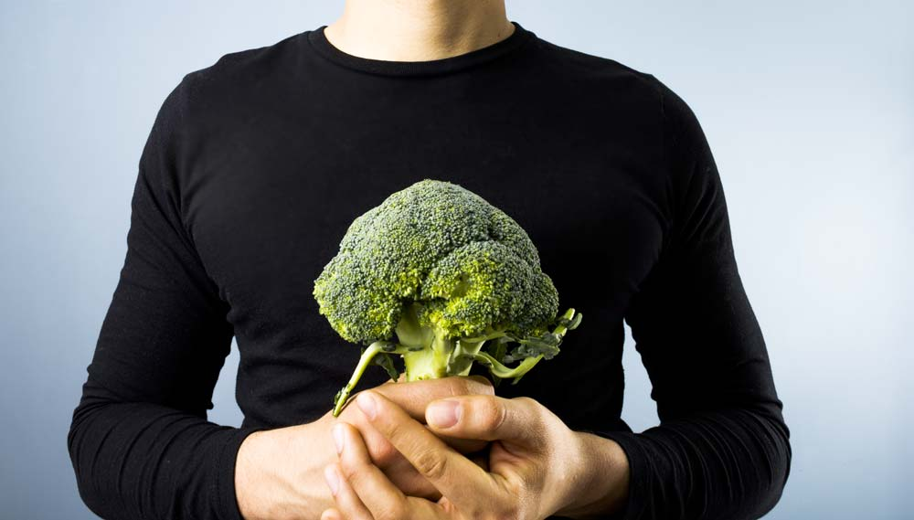 man with broccoli